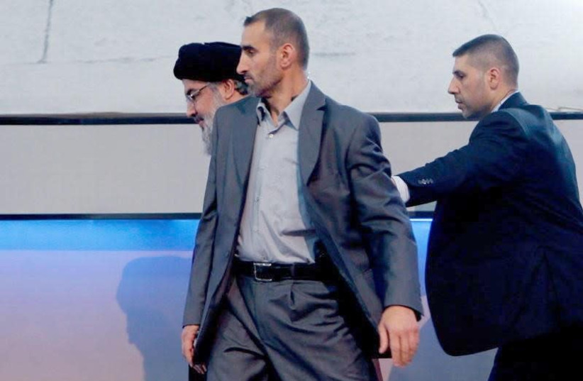 Musa Muhamad Wahabi, Hezbollah bodyguard (Center)  (photo credit: ARAB MEDIA)