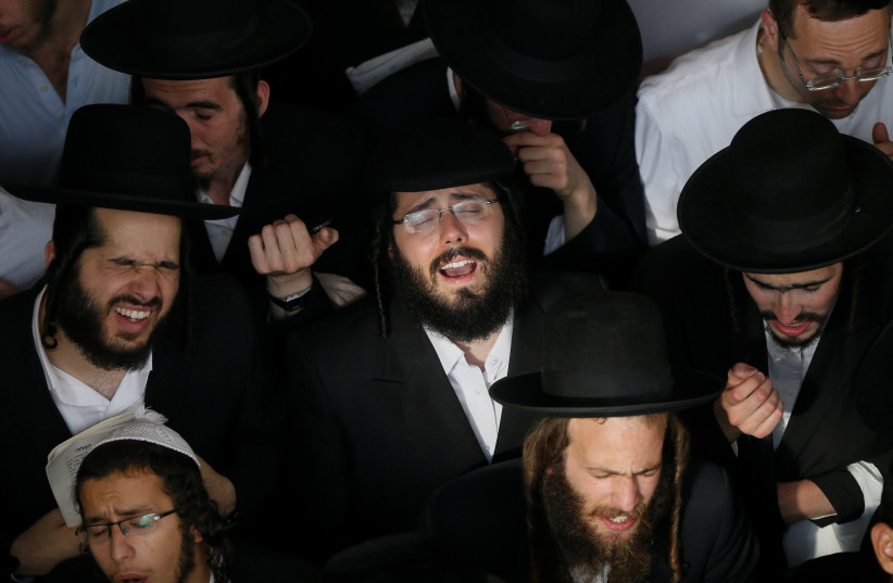 Ultra-Orthodox Jewish pilgrims pray at the tomb of Rabbi Nachman of Breslov on the eve of Rosh Hashanah holiday, the Jewish New Year, in the town of Uman, Ukraine September 20, 2017. (photo credit: REUTERS)