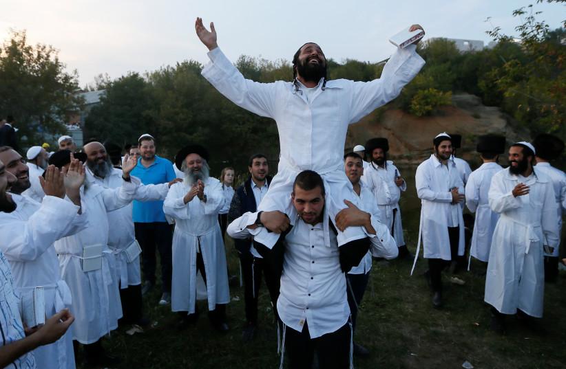 Ultra-Orthodox Jewish pilgrims celebrate the Rosh Hashana holiday, the Jewish New Year, near the tomb of Rabbi Nachman of Breslov in Uman, Ukraine, September 21, 2017. (photo credit: REUTERS)