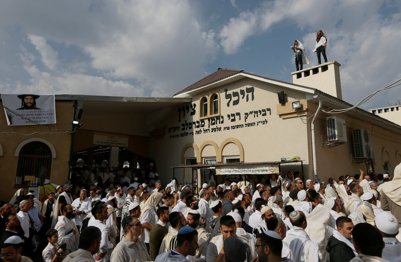 Ultra-Orthodox Jewish pilgrims pray at the tomb of Rabbi Nachman of Breslov during the celebration of Rosh Hashana holiday, the Jewish New Year, in Uman, Ukraine, September 21, 2017. (photo credit: REUTERS)