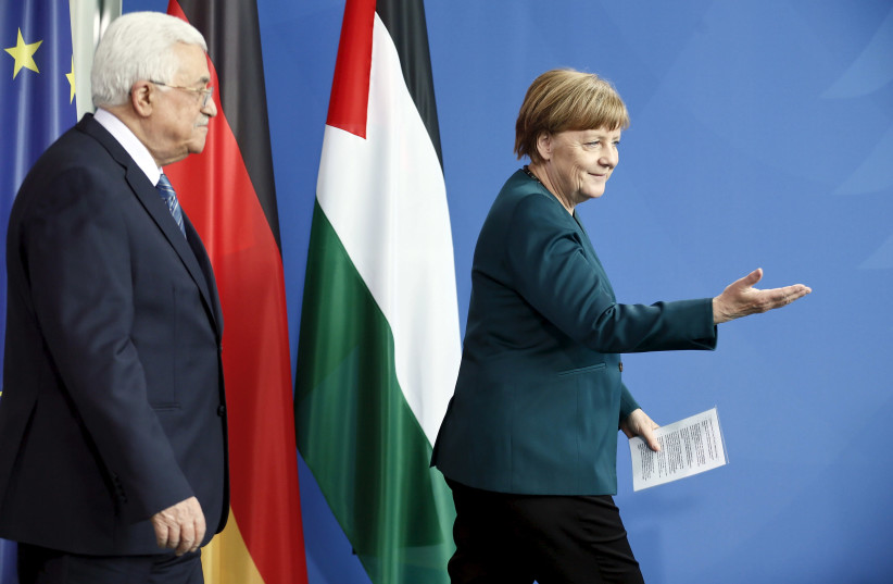 Chancellor Angela Merkel and Palestinian President Mahmoud Abbas arrive for a news conference at the Chancellery in Berlin, Germany, April 19, 2016. (photo credit: REUTERS)
