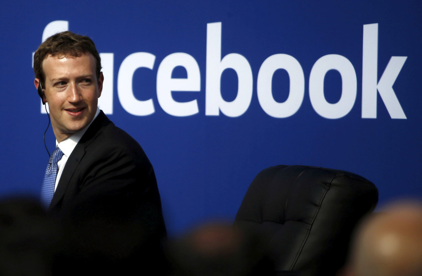 Facebook CEO Mark Zuckerberg is seen on stage during a town hall at Facebook's headquarters in Menlo Park, California September 27, 2015. (photo credit: REUTERS)