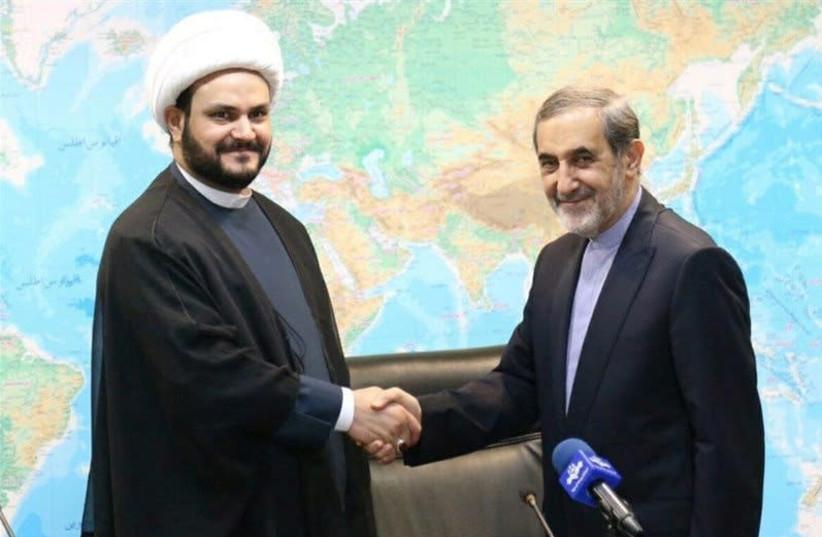 Akram Kaabi, the leader of Nujaba, meets with Ali Akbar Velayati, senior advisor to the supreme leader. (photo credit: REUTERS)