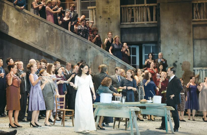 Evgenia Muraveva (Katerina), Brandon Jovanovich (Sergei), and the Vienna State Opera Chorus in Shostakovich's 'Lady Macbeth of the Mtsensk District.' (photo credit: SALZBURGER FESTSPIELE/THOMAS AURIN)