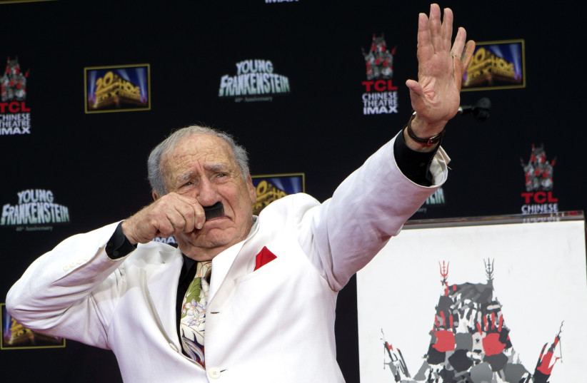 Filmmaker and comedian Mel Brooks gestures as he places his footprints in cement, with a fake sixth finger attached to his left hand, in the forecourt of the TCL Chinese theatre in Hollywood, California September 8, 2014. (photo credit: MARIO ANZUONI/REUTERS)