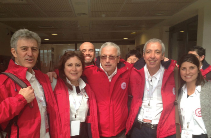 Dr. Michel Alimi (second from the right) with a team of other French medical professionals. (photo credit: Courtesy)