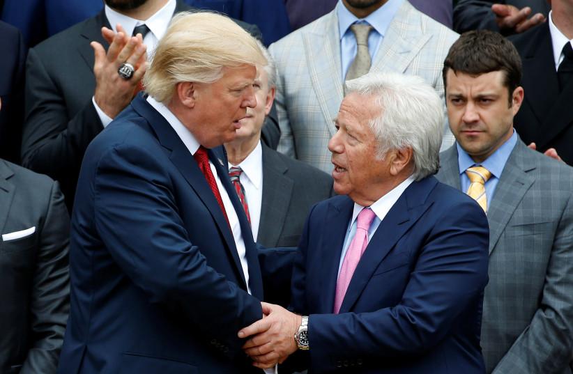 Donald Trump with Patriots owner Robert Kraft. (photo credit: JOSHUA ROBERTS / REUTERS)