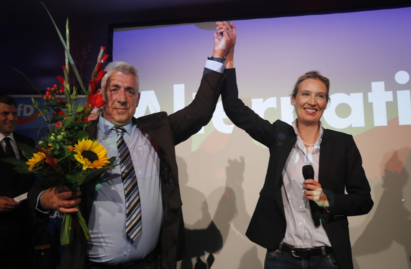 Alice Weidel (R), top candidate of the anti-immigration party Alternative fuer Deutschland (AfD) reacts after first exit polls in the German general election (Bundestagswahl) in Berlin, Germany, September 24, 2017.  (photo credit: WOLFGANG RATTAY / REUTERS)
