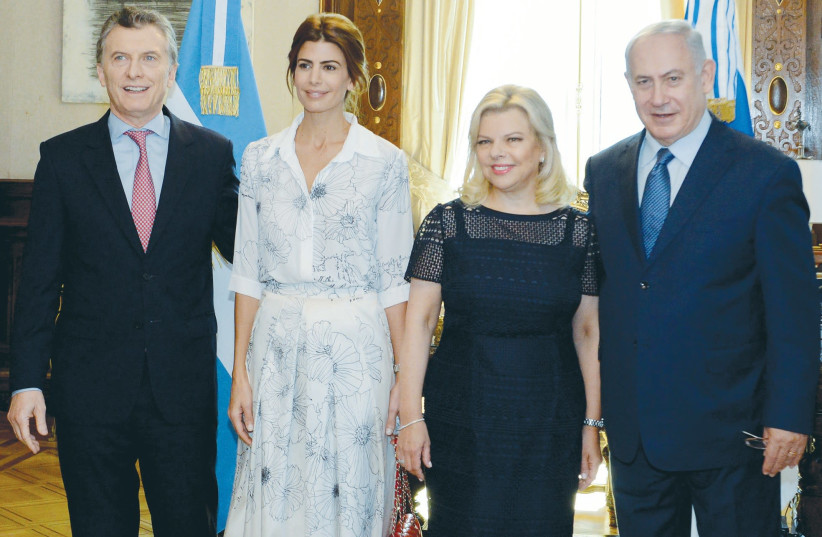 Benjamin Netanyahu (right) stands next to his wife, Sara, along with Argentinian President Mauricio Macri and First Lady Juliana Awada during a meeting on September 12 at the presidential palace in Buenos Aires.  (photo credit: ARGENTINE PRESIDENCY/REUTERS)