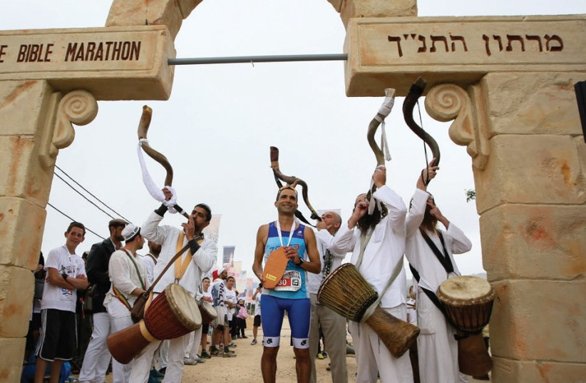 MUSICIANS DRESSED in biblical attire accompany runners during a previous Bible Marathon, which takes place next month in the Binyamin region in the West Bank. (photo credit: BIBLE MARATHON)