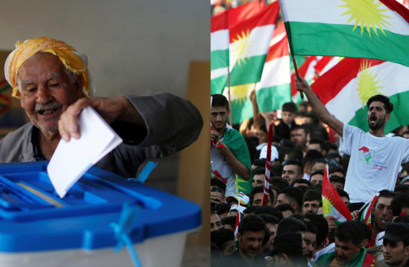 A man casts his vote during Kurds independence referendum in Erbil, Iraq September 25, 2017, beside a picture of Kurds showing their support for the Kurdish independence referendum. (photo credit: AHMED JADALLAH / REUTERS)