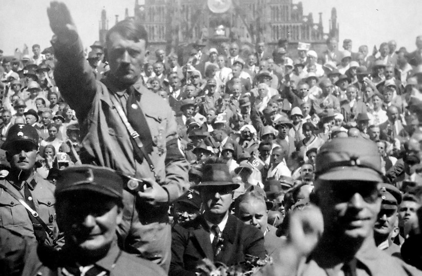 Hitler and Hermann Göring saluting at a 1928 Nazi Party rally in Nuremberg (photo credit: PUBLIC DOMAIN / HEINRICH HOFFMANN / US NATIONAL ARCHIVES AND RECORDS ADMINISTRATION)