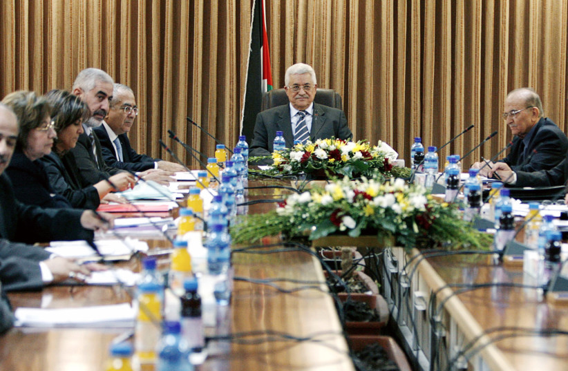 Palestinian Authority President Mahmoud Abbas attends a cabinet meeting in the West Bank city of Ramallah July 4, 2007. (photo credit: REUTERS)