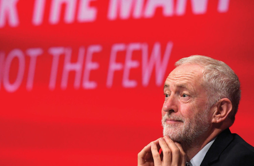 BRITAIN'S OPPOSITION Labour Party leader Jeremy Corbyn listens to speeches at the Labour Party Conference venue in Brighton yesterday. (photo credit: REUTERS)