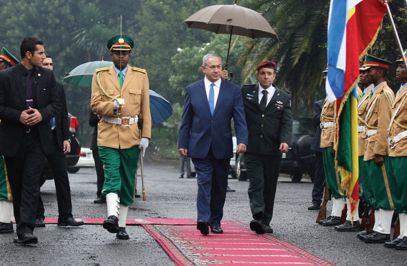 PRIME MINISTER Benjamin Netanyahu inspects a guard of honor at the National Palace during his state visit to Addis Ababa, Ethiopia, last July. (photo credit: REUTERS)