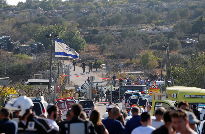 A general view of the scene of the terror attack in Har Adar (photo credit: AMMAR AWAD / REUTERS)