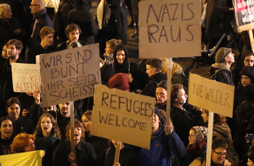 Demonstrators protest against the anti-immigration party Alternative fuer Deutschland (AfD) after German general election (photo credit: WOLFGANG RATTAY / REUTERS)