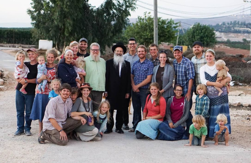 The Waller family with Rabbi Eliezer Melamed.  (photo credit: HAYOVEL)