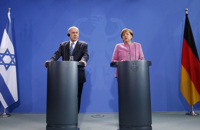 Israeli PM Netanyahu and German Chancellor Merkel address a news conference (photo credit: FABRIZIO BENSCH / REUTERS)
