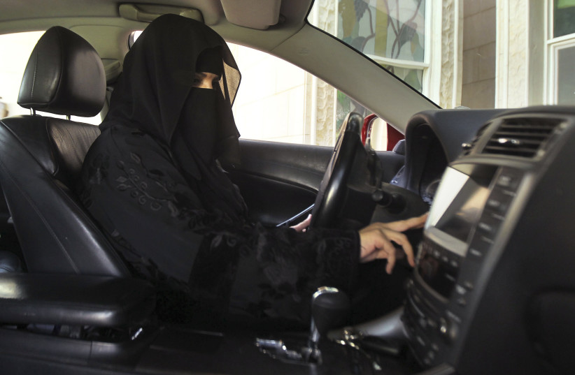 Despite being barred from driving, a woman drives a car in Saudi Arabia, October 22, 2013. (photo credit: REUTERS)