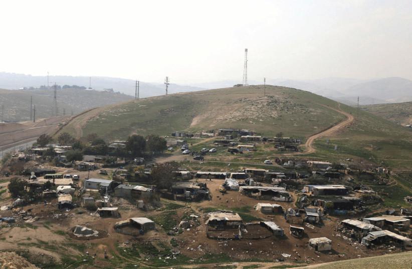 THE BEDUIN encampment of Khan al-Ahmar is seen near Ma'aleh Adumim. (photo credit: AMMAR AWAD / REUTERS)