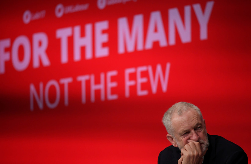 Britain's opposition Labour party leader Jeremy Corbyn listens to speeches during the Labour party Conference in Brighton, Britain, September 24, 2017. (photo credit: REUTERS)