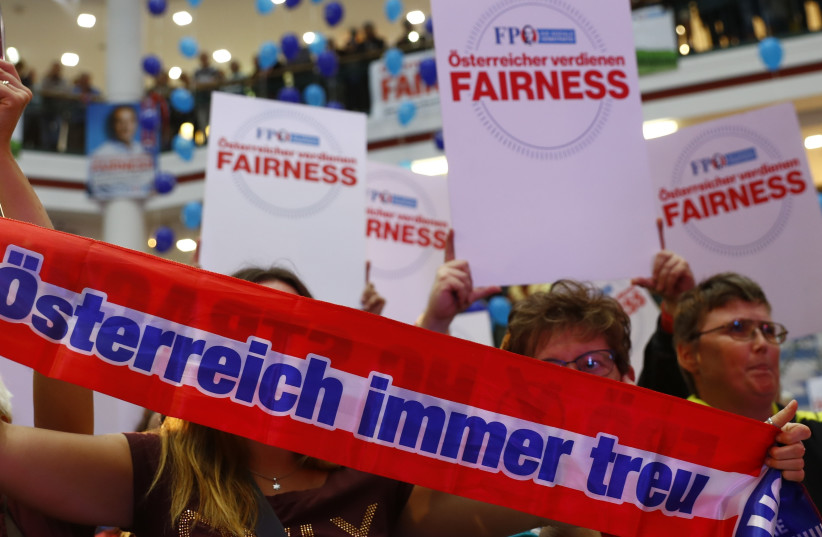 Supporters wait for Head of Austrian far-right Freedom Party (FPO) Heinz-Christian Strache during an election campaign rally in Vienna, Austria (photo credit: REUTERS)
