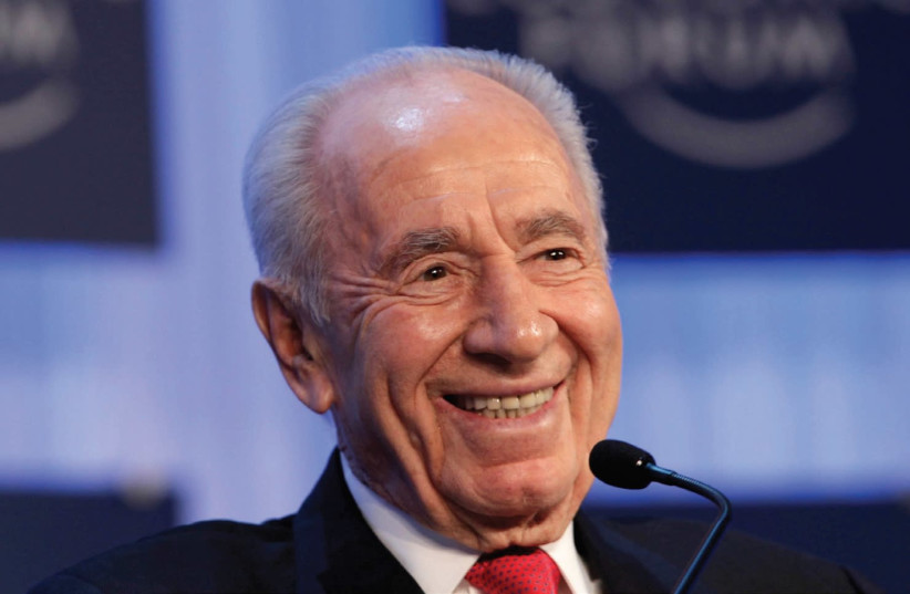 SHIMON PERES smiles during the annual meeting of the World Economic Forum (WEF) in Davos in 2013. (photo credit: REUTERS)