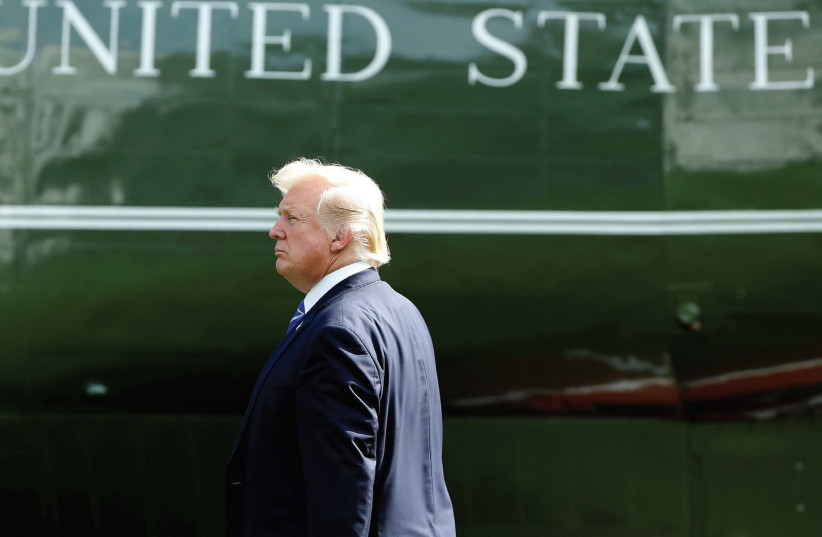 THE AUTHOR urges us not to applaud. US President Donald Trump walks to Marine One. (photo credit: REUTERS)