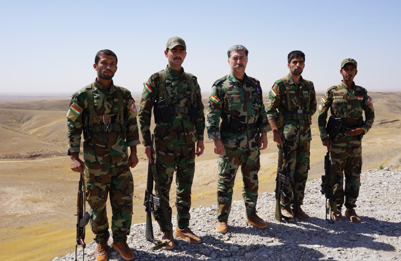 Kurdish Peshmerga (center) leader Hussein Yazdanpanah with his men on the frontline with ISIS west of Kirkuk (photo credit: SETH J. FRANTZMAN)