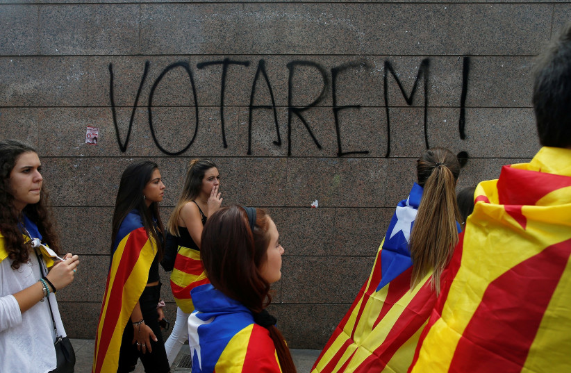 Students in Catalonia march in support of the region's independence, September 2017 (photo credit: JON NAZCA/ REUTERS)