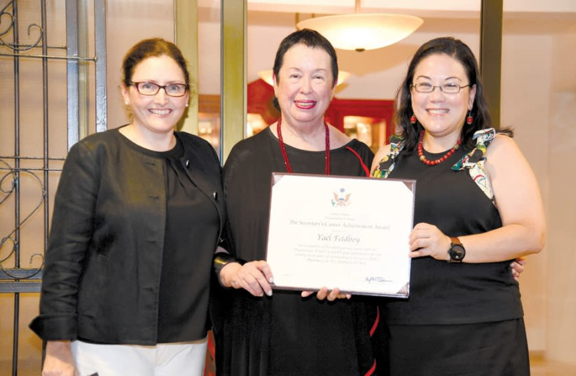 YAEL FELDBOY, flanked by US Embassy spokeswoman Valerie O'Brien (left) and deputy chief of mission Leslie Tsou, displays the Secretary of State's Career Achievement Award in recognition of her distinguished service. (photo credit: US EMBASSY)