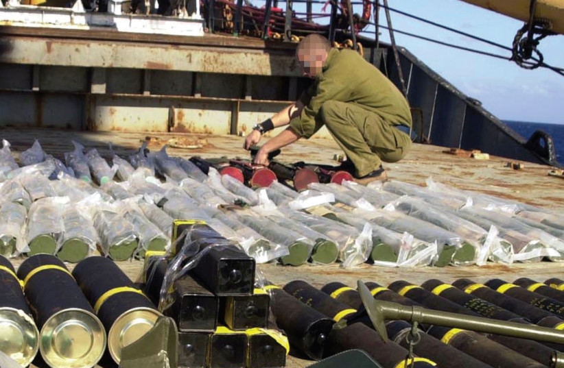 WEAPONS CONFISCATED aboard the Karine A, a ship laden with weapons destined for the Palestinians but intercepted by Israeli forces in January 2002, are displayed on the deck of the vessel. (photo credit: REUTERS)