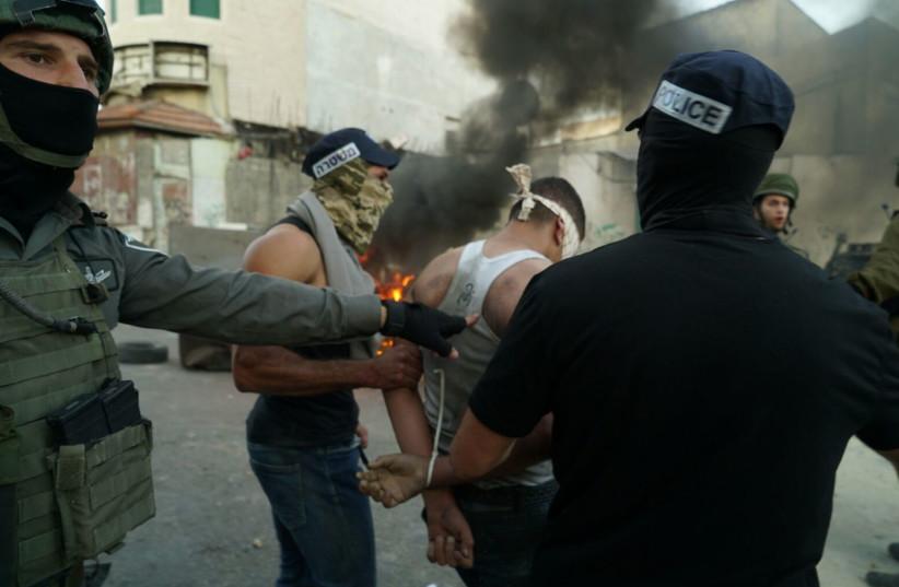 Border Police arrest Palestinians rioting in the West Bank village of Biddu, September 2017 (photo credit: POLICE SPOKESPERSON'S UNIT)