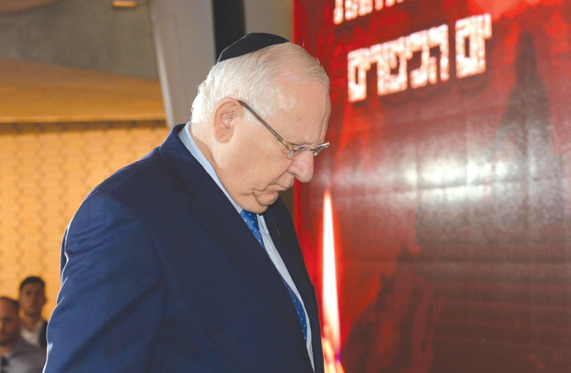 PRESIDENT REUVEN RIVLIN observes a moment of silence during a ceremony at Mount Herzl yesterday commemorating the outbreak of the 1973 Yom Kippur War. (photo credit: MARC NEYMAN/GPO)