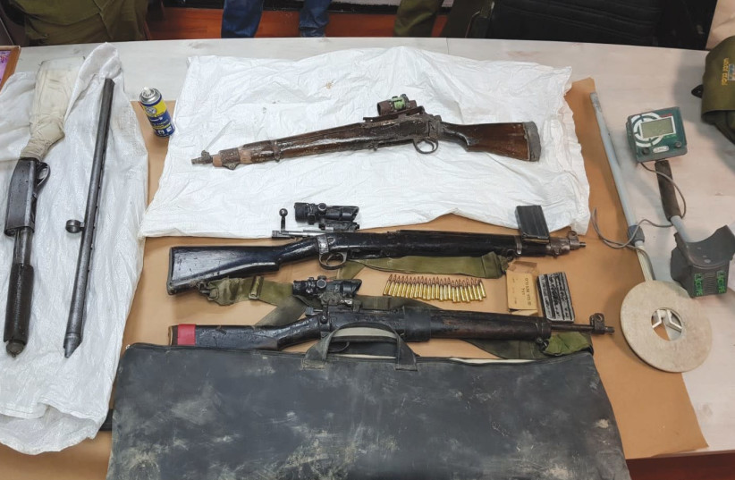 WEAPONS seized during overnight raids in the West Bank village of Bani Naim are displayed by the Israel Police. (photo credit: ISRAEL POLICE)