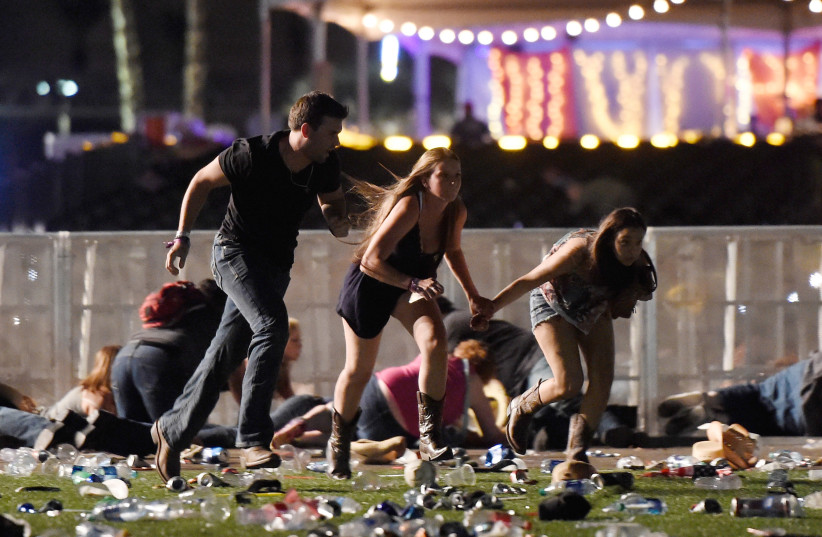 People run from the Route 91 Harvest country music festival after gun fire was heard (photo credit: DAVID BECKER/GETTY IMAGES/AFP)