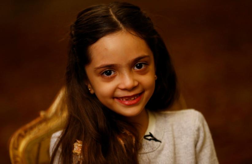 Bana Alabed smiles during an interview in Ankara (photo credit: UMIT BEKTAS / REUTERS)