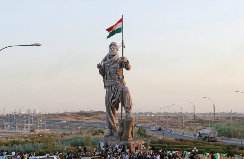 A STATUE of a Peshmerga fighter in Kirkuk. Kurds voted, now the question shifts to what their neighbors will do. (photo credit: REUTERS)