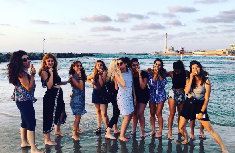 Participants, who this past summer came from the US, Canada and Argentina, spend the day on a Tel Aviv beach. (photo credit: IRA KHRAKOVSKY DOTAN)