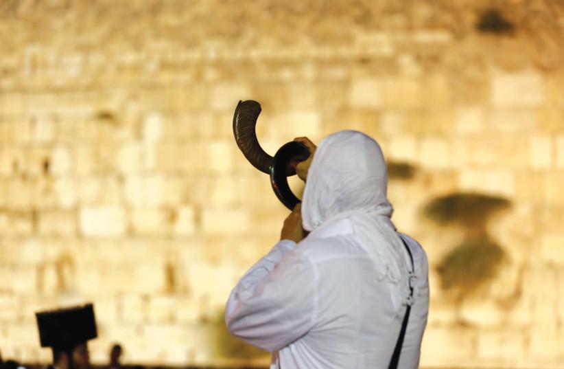 A Jewish man praying at the Western Wall (photo credit: REUTERS)