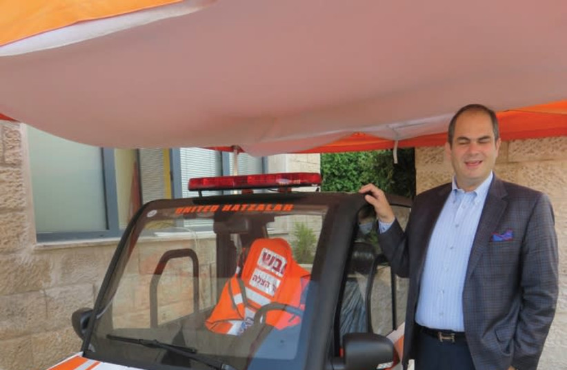 United Hatzalah president and founder Eli Beer stands by a new minilance emergency vehicle. (photo credit: JUDY SIEGEL-ITZKOVICH)