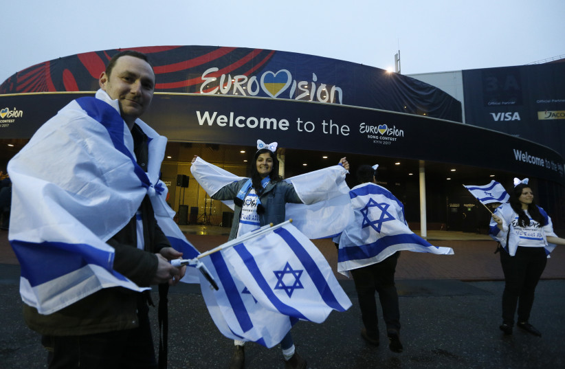 Israel's fans wave flags before the Eurovision Song Contest 2017 Grand Final at the International Exhibition Centre in Kiev, Ukraine, May 13, 2017. (photo credit: REUTERS)