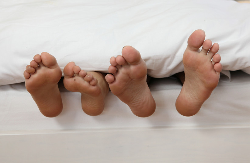 Couple in bed [file photo] (photo credit: INGIMAGE)