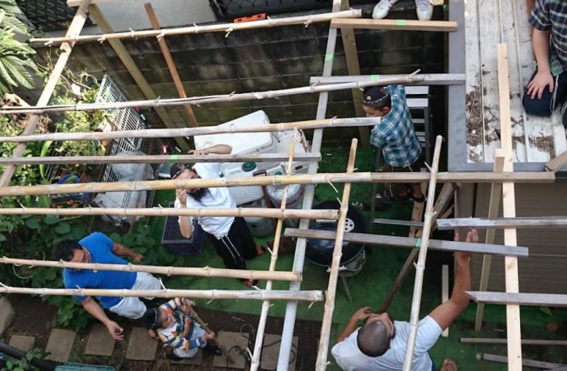 Chabad of Tokyo building a Sukka (photo credit: FACEBOOK SCREENSHOT)
