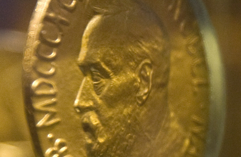 An 18-carat gold Nobel Peace Prize medal, awarded in 1921 to Norway's Christian L. Lange, is seen in an exhibition at the Nobel Peace Centre in Oslo December 9, 2009. (photo credit: REUTERS)