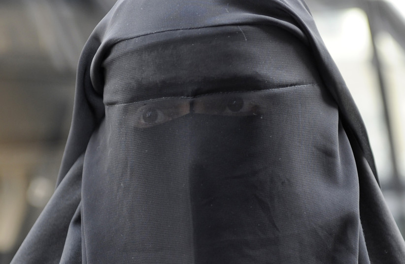 A woman who identified herself as Nayet, wearing a burqa, is seen after her release from a police station in Paris April 11, 2011. (photo credit: REUTERS)