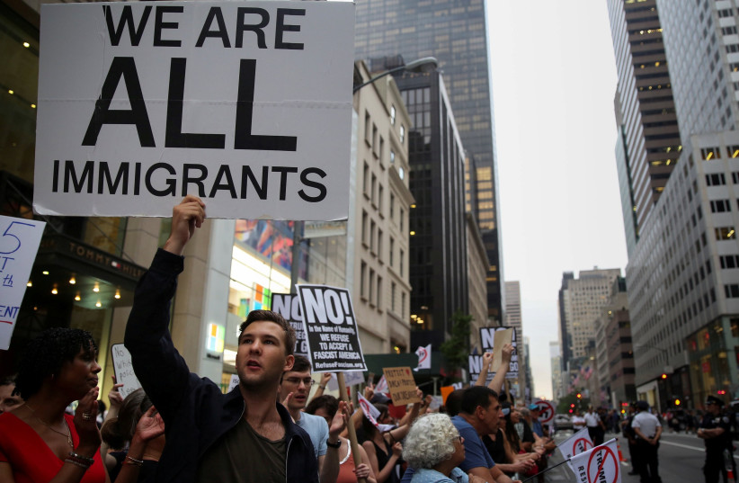 A protest against Trump's immigration policies outside Trump Tower, Manhattan, August 2017 (photo credit: REUTERS/AMR ALFIKY)