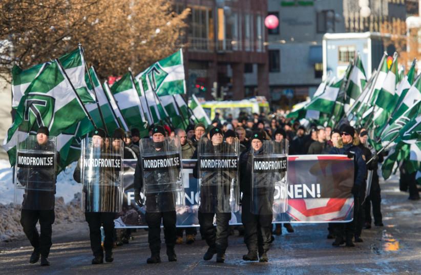 Une manifestation du mouvement néonazi, Nordfront, en Suède (photo credit: AFP PHOTO)