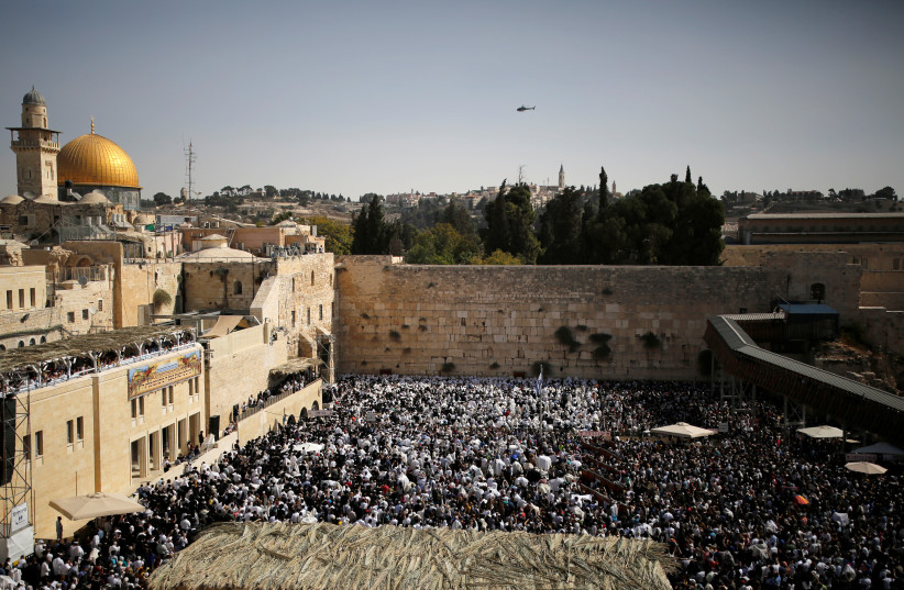 A general view shows Jewish worshippers at the Western Wall, Judaism's holiest prayer site, in Jerusalem's Old City (photo credit: REUTERS/AMIR COHEN)